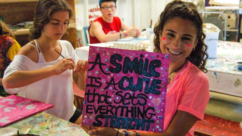 girl showing off artwork