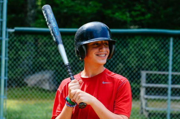 camper holding baseball bat
