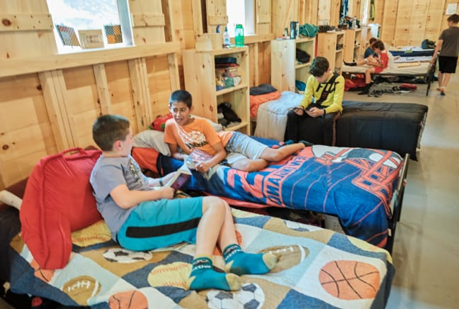 boys reading in bunk