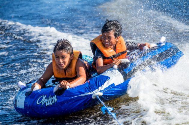 two boys watertubing