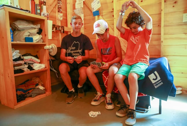 campers playing cards in bunk