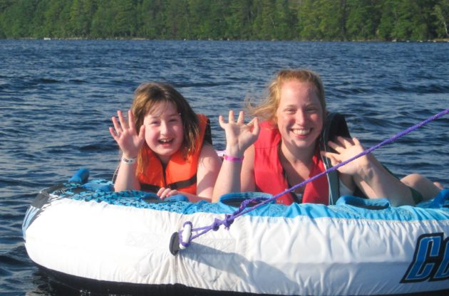 sisters tubing at family camp
