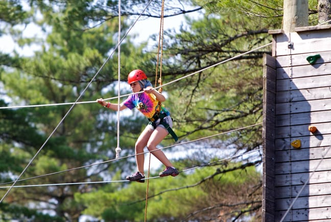 girl crossing ropes course