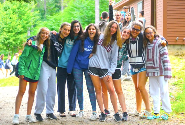 group of girls by their cabin