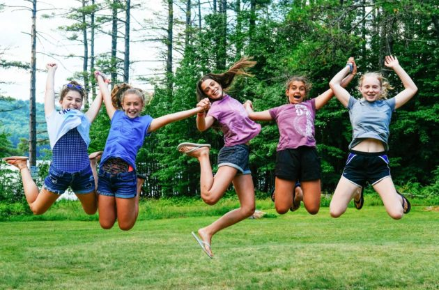 girls jumping in air