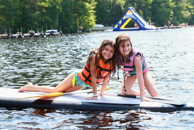two girls on sup board