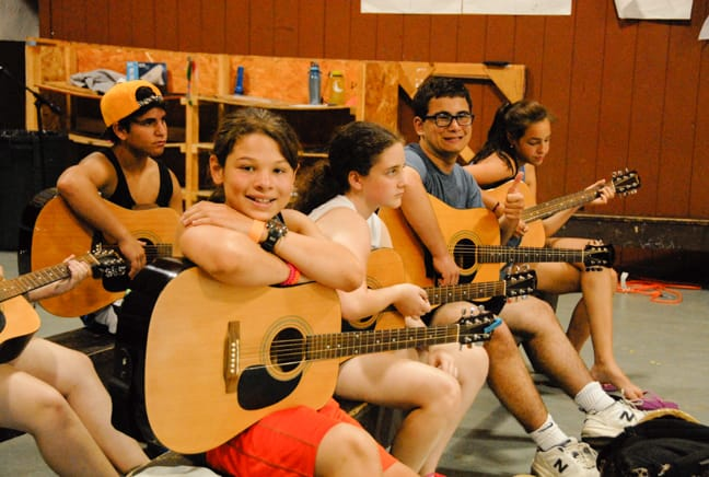 campers playing guitar in the old rec