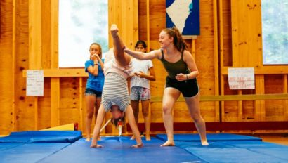 instructor teaching gymnastics