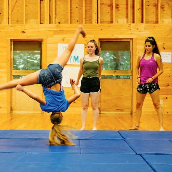 gymnastics girl doing a flip