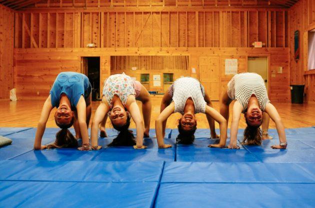 Four girls upside down at gymnastics