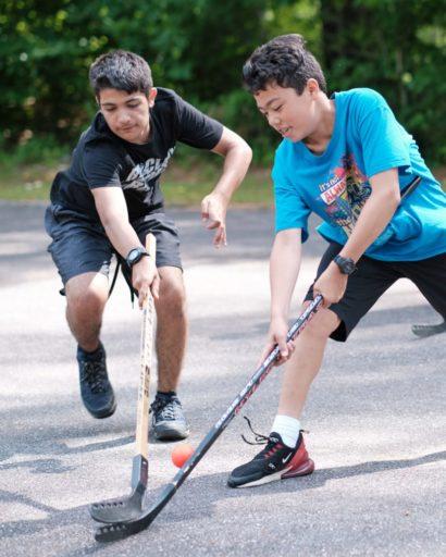 two boys playing hockey