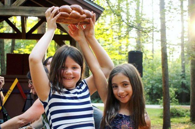 girls holding challah