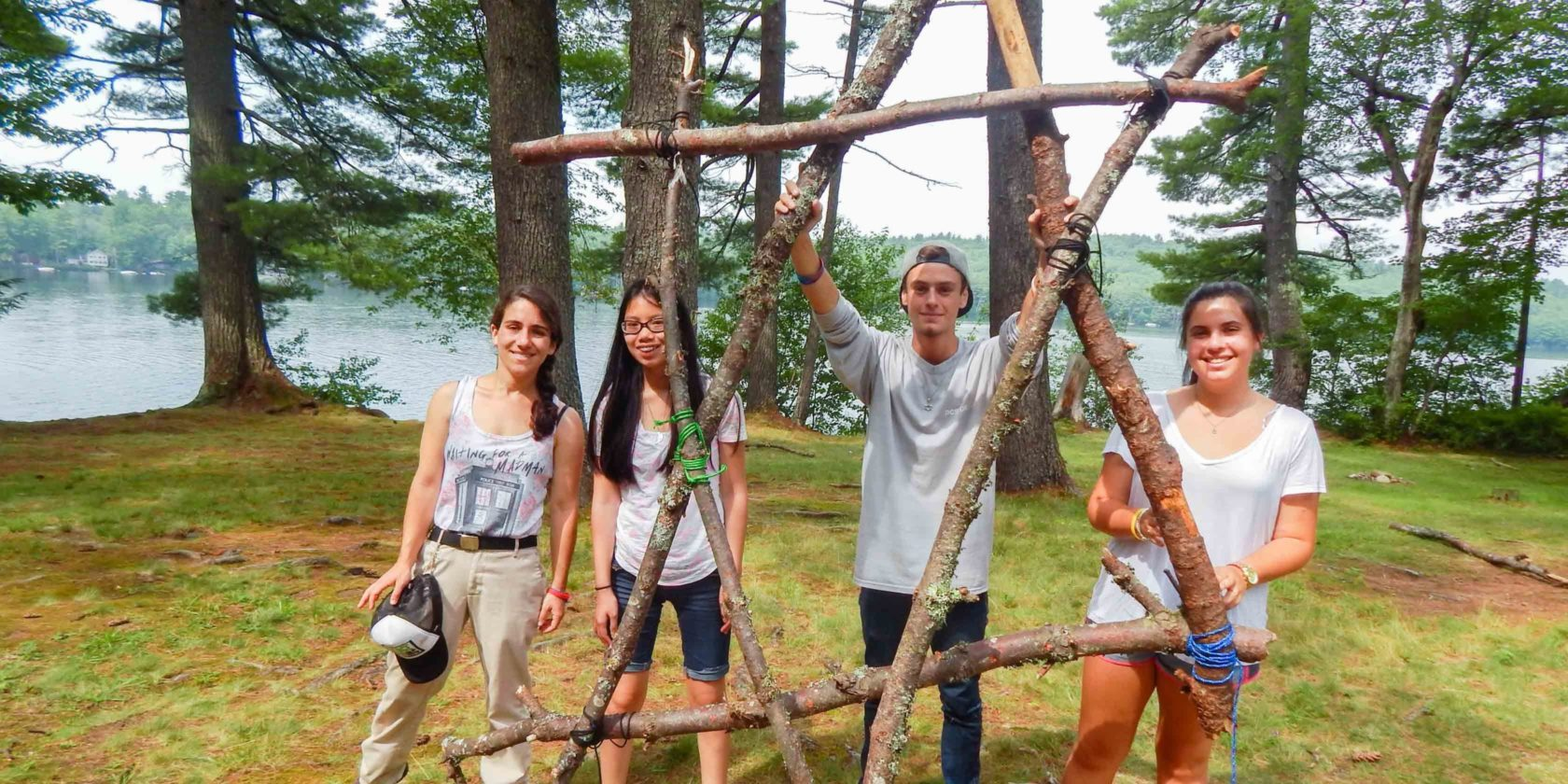 4 campers by wooden star of david