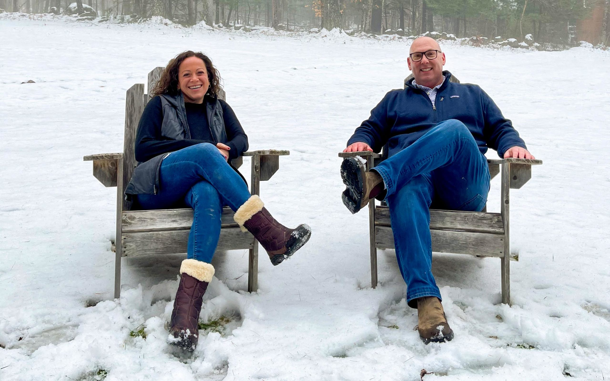 jodi and mitch sitting outside in winter