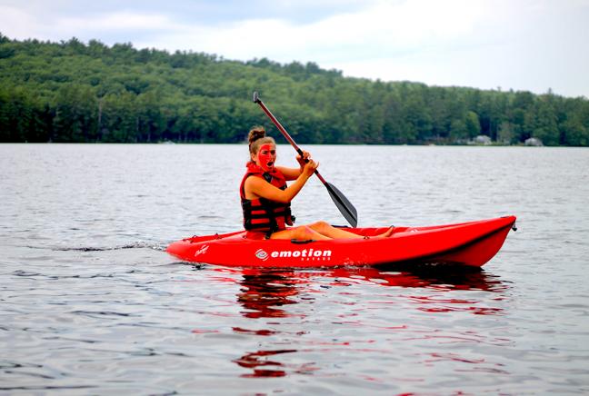 girl kayaking on the lake