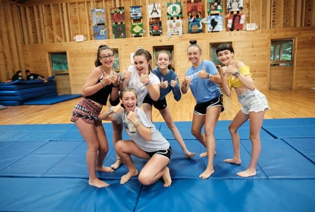 girls on a gymnastics mat