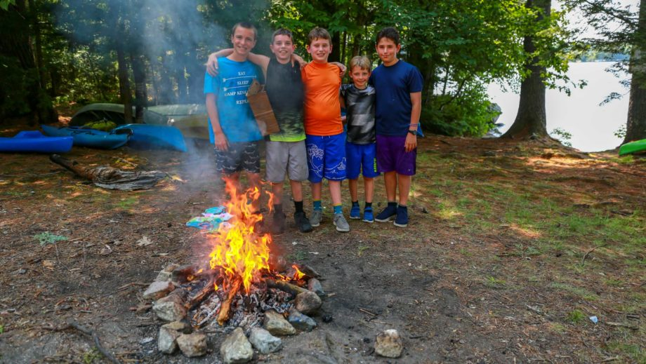 boys by a campfire they built