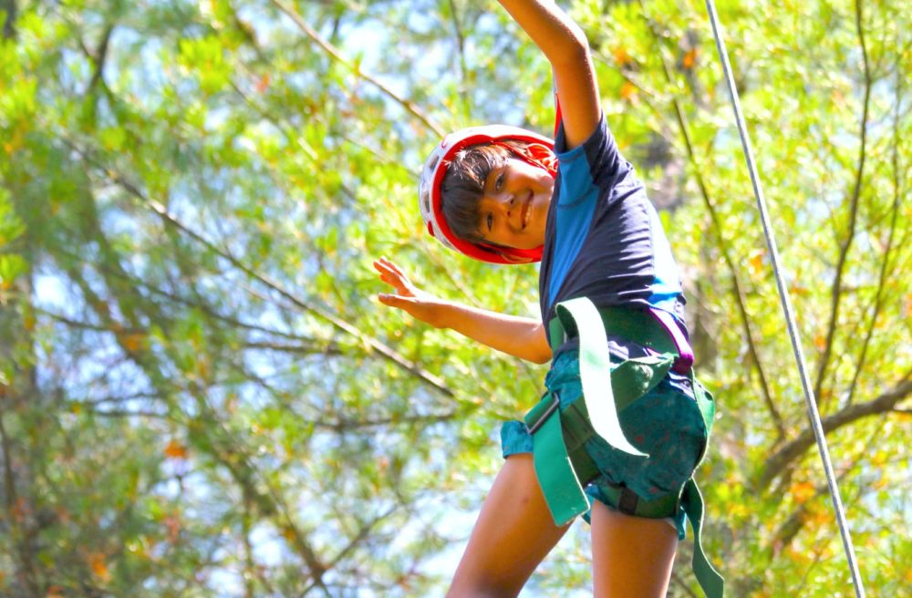 boy on ropes course