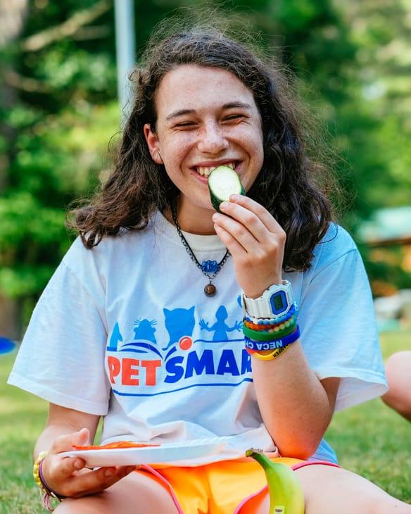 camper eating a snack outside