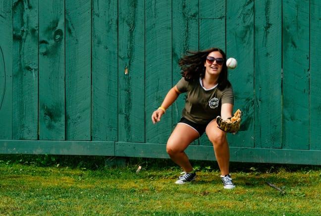 girl catching a softball