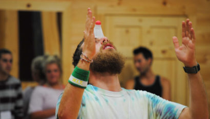 balancing a bottle at a special event