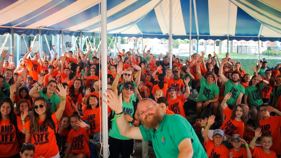 campers at color war event under a tent