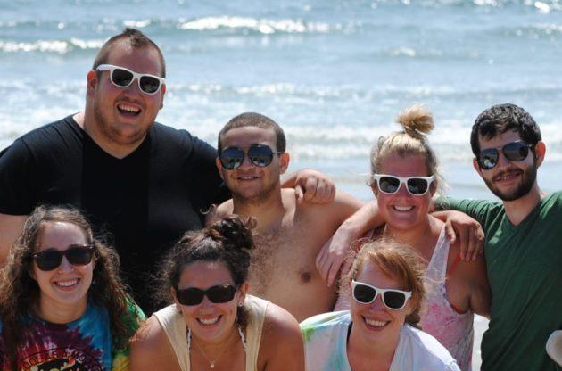 staff posing by the ocean