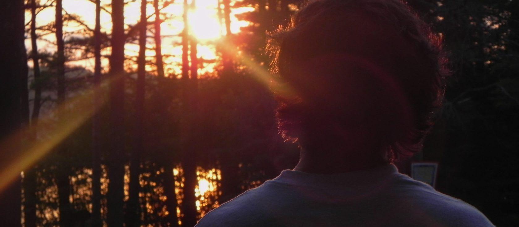 camper watching a sunset