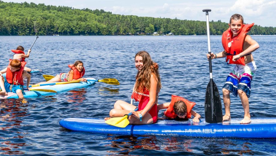 campers on sup boards