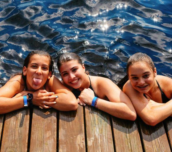 three girls by dock