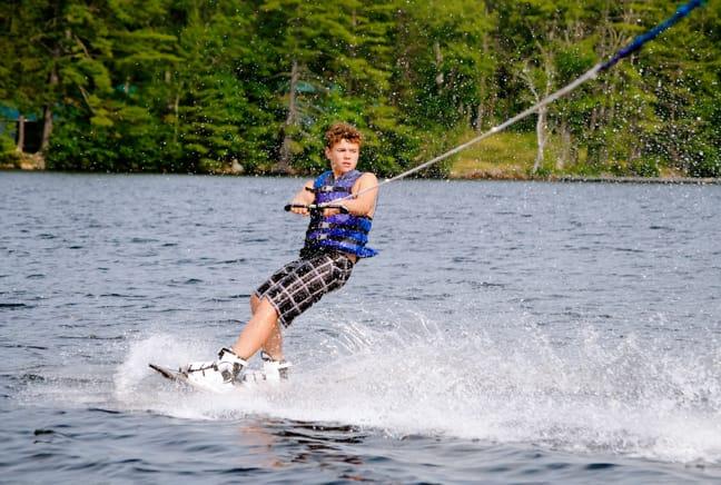 boy waterskiing on the lake