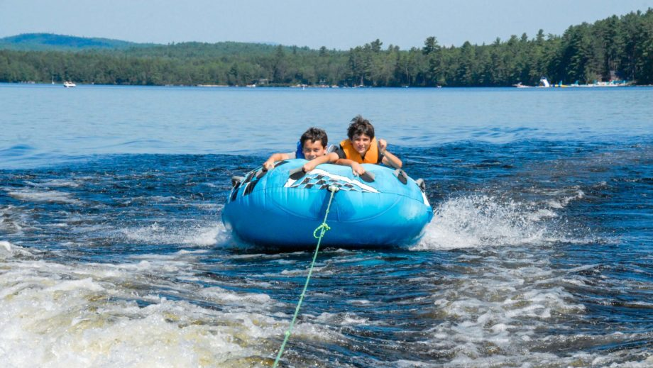 boys watertubing