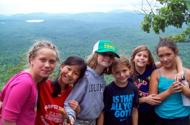 girls on a hiking trip with white mountains in the background